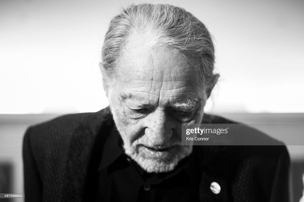 Willie Nelson check out artifacts after attending the 2015 Gershwin Prize Luncheon where he was honored with a certificate and an American flag in the Thomas Jefferson Building of the Library of Congress on November 17, 2015 in Washington, DC.