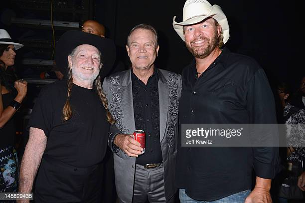 Willie Nelson Glen Campbell and Toby Keith attend the 2012 CMT Music awards at the Bridgestone Arena on June 6 2012 in Nashville Tennessee