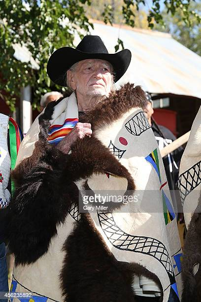 Willie Nelson is honored during a ceremony where he and Neil Young were presented with decorated buffalo hides before the Harvest The Hope Concert in...