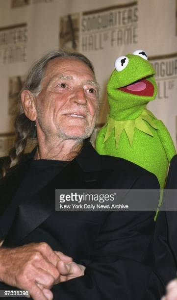 Willie Nelson is serenaded by Kermit the Frog at the Songwriters Hall of Fame's annual induction ceremonies at the Sheraton Hotel Nelson was among...