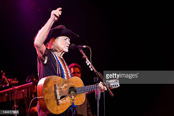Willie Nelson performing live at the Hammersmith Apollo, London with 'Trigger', his trusty Martin N-20 guitar.