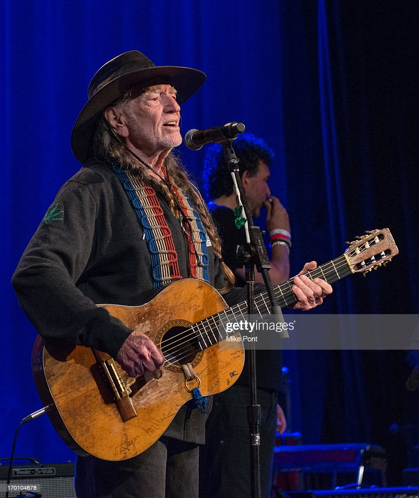 Willie Nelson performs at Hard Rock International's Wille Nelson Artist Spotlight Benefit Concer at Hard Rock Cafe, Times Square on June 6, 2013 in New York City.