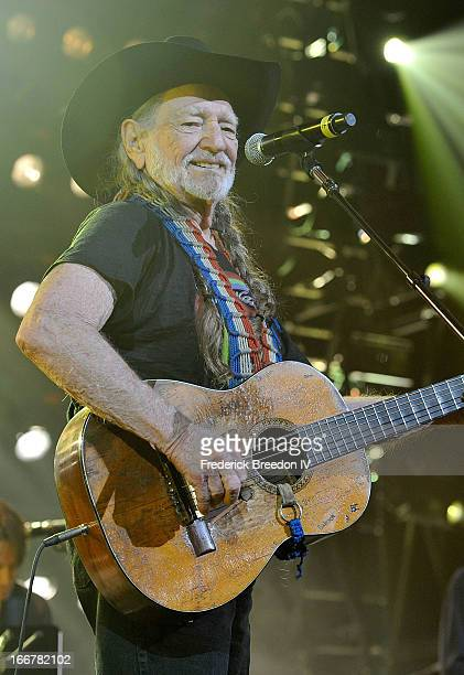 Willie Nelson performs during Keith Urban's Fourth annual We're All For The Hall benefit concert at Bridgestone Arena on April 16, 2013 in Nashville,...