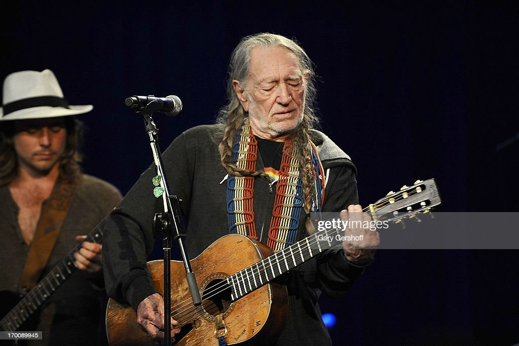 Willie Nelson performs on stage at Hard Rock International's Wille Nelson Artist Spotlight Benefit Concert at Hard Rock Cafe, Times Square on June 6, 2013 in New York City.