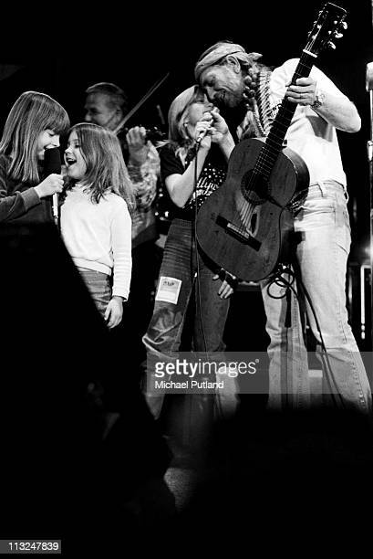 Willie Nelson performs on stage with his and Kris Kristofferson's children New York 1980