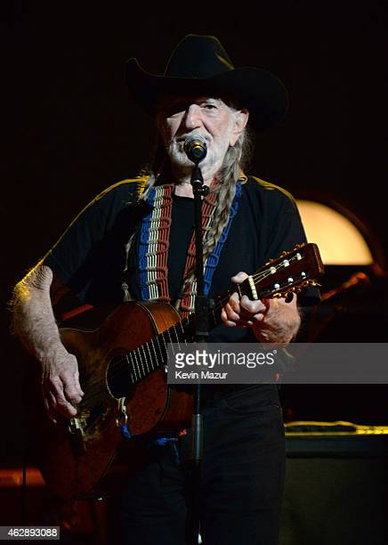 Willie Nelson performs onstage at the 25th anniversary MusiCares 2015 Person Of The Year Gala honoring Bob Dylan at the Los Angeles Convention Center...
