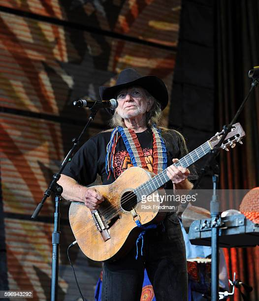 Willie Nelson performs with Nation Beat at the Farm Aid concert at the Comcast Center in Mansfield