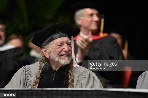 Willie Nelson receives an Honorary Doctor of Music Degree during the 2013 Berklee College Of Music Commencement Ceremony at Berklee College of Music...