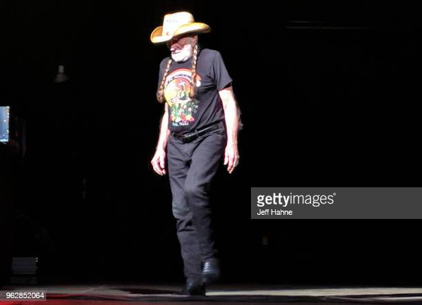 Willie Nelson walks out on stage at PNC Music Pavilion on May 26 2018 before promptly walking off and canceling the show in Charlotte North Carolina