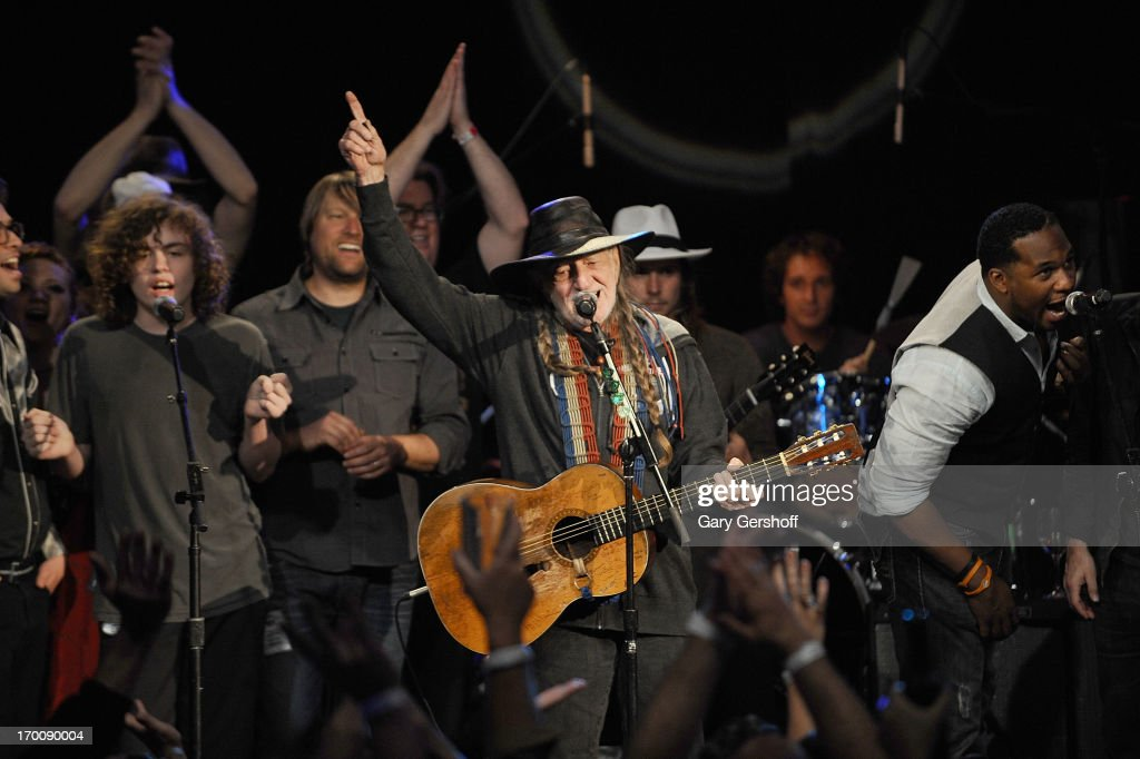 Willie Nelson (C) with family and friends perform on stage at the Hard Rock International's Wille Nelson Artist Spotlight Benefit Concert at Hard Rock Cafe, Times Square on June 6, 2013 in New York City.