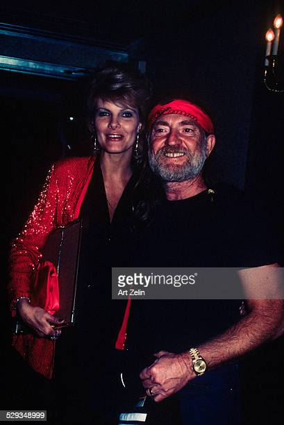 Willie Nelson with his wife Connie Keopke She is wearing a red sequined jacket circa 1970 New York