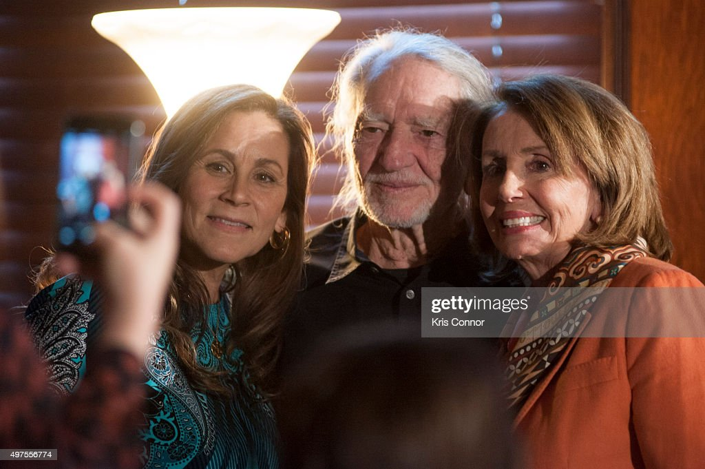 Willie Nelson with wife Annie D'Angelo and Rep. Nancy Pelosi (D-CA) attend the 2015 Gershwin Prize Luncheon Honoring Willie Nelson in the Thomas Jefferson Building of the Library of Congress on November 17, 2015 in Washington, DC.