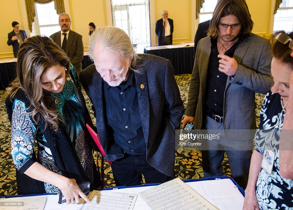 Willie Nelson with wife Annie D'Angelo check out artifacts after attending the 2015 Gershwin Prize Luncheon where he was honored with a certificate and an American flag in the Thomas Jefferson Building of the Library of Congress on November 17, 2015 in Washington, DC.