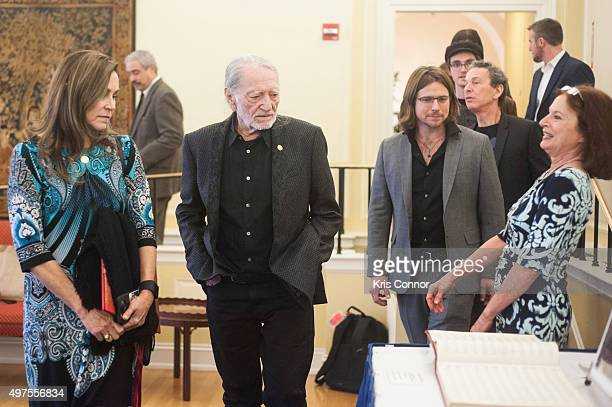 Willie Nelson with wife Annie D'Angelo sons Lukas Nelson and Micah Nelson check out artifacts after attending the 2015 Gershwin Prize Luncheon where...