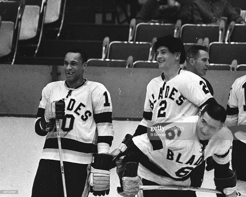Willie O'Ree #10 and Howie Young #2 of the Los Angeles Blades talk during warm ups before their game at the Los Angeles Sports Arena during the 1963-64 season in Los Angeles, California.
