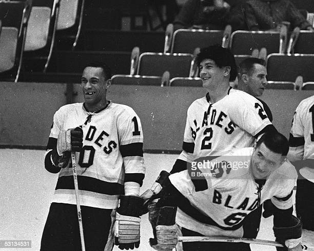 Willie O'Ree and Howie Young of the Los Angeles Blades talk during warm ups before their game at the Los Angeles Sports Arena during the 196364...