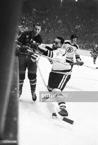 Willie O'Ree of the Boston Bruins in action during game against the N.Y. Rangers. O'Ree is the first Black player in professional hockey.