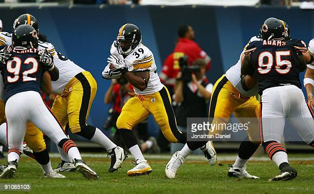 Willie Parker of the Pittsburgh Steelers runs through the hole as Hunter Hillenmeyer and Anthony Adams of the Chicago Bears are blocked on September...