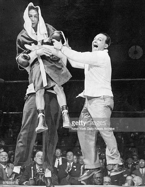 Willie Pep gets lifted by manager Lou Viscusi after regaining the featherweight championship in bout against Sandy Saddler at Madison Square Garden