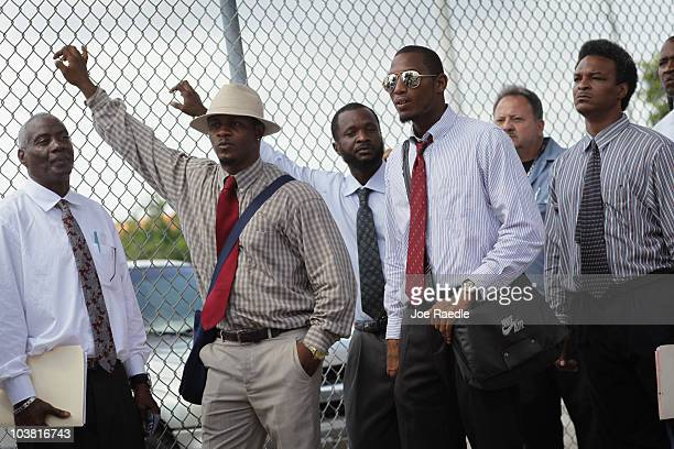 Willie Pierce Adrian Alvin Derrick Powell and Bobby Mitchell stand in line as they wait to apply for a job with Miami's Community Redevelopment...