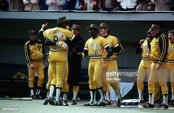 Willie 'Pops' Stargell of the Pittsburgh Pirates is congratulated after scoring during World Series game three between the Pittsburgh Pirates and...