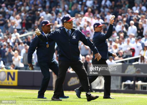 Willie Randolph Joe Torre and Tino Martinez throw out the first pitch before the game between the New York Yankees and the Tampa Bay Rays during the...