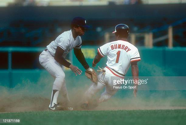 Willie Randolph of the New York Yankees puts the tag on Al Bumbry of the Baltimore Orioles during an Major League Baseball game circa 1981 at Yankee...