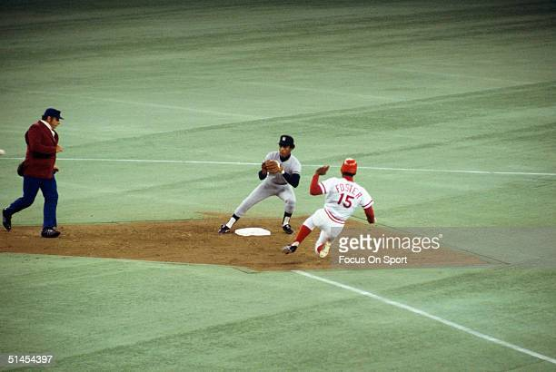 Willie Randolph of the New York Yankees waits for a throw to tag out George Foster of the Cincinnati Reds at second base during the World Series at...