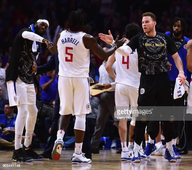 Willie Reed Montrezl Harrell and Blake Griffin of the LA Clippers celebrate a lead during a timeout in a 113102 Clipper win over the Houston Rockets...