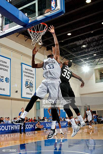Willie Reed of the Brooklyn Nets jumps for the rebound against DaJuan Summers of the Brooklyn Nets on July 5 2014 at Amway Center in Orlando Florida...