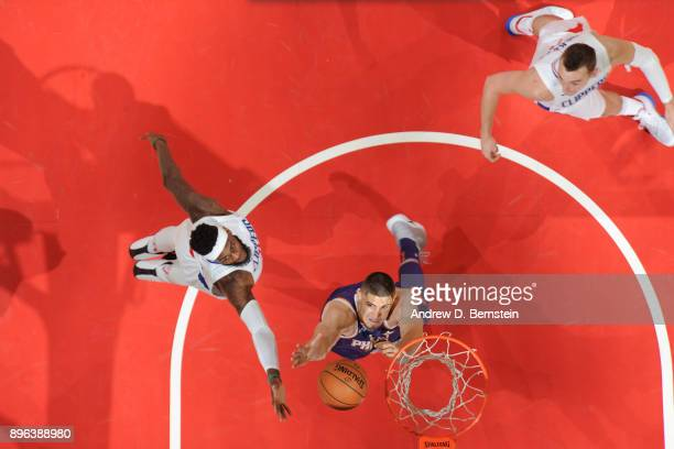 Willie Reed of the LA Clippers and Alex Len of the Phoenix Suns go for a rebound on December 20 2017 at STAPLES Center in Los Angeles California NOTE...