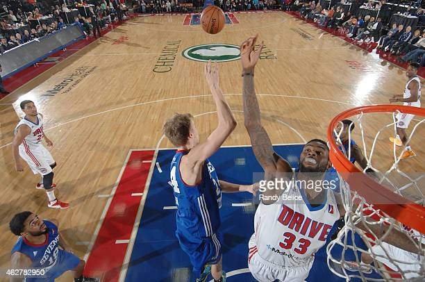 Willie Reed of the Grand Rapids Drive battles for a rebound with Joonas Caven of the Delaware 87ers during the NBA D-League game on January 31, 2015...