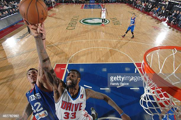 Willie Reed of the Grand Rapids Drive battles for the ball with Drew Gordon of the Delaware 87ers during the NBA D-League game on January 31, 2015 at...