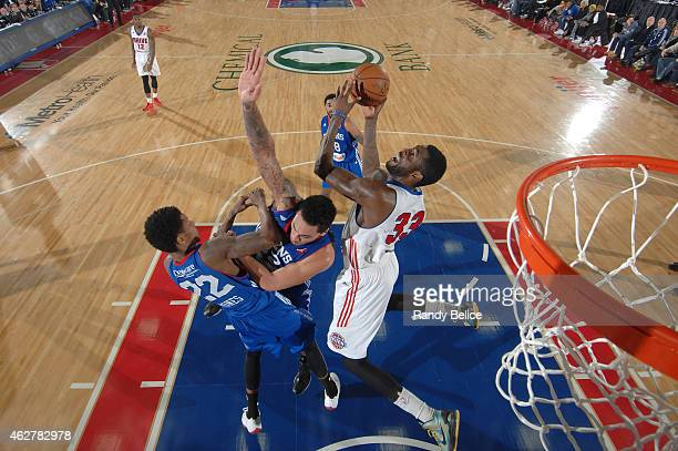Willie Reed of the Grand Rapids Drive grabs a rebound from Jamal Jones and Drew Gordon of the Delaware 87ers during the NBA DLeague game on January...