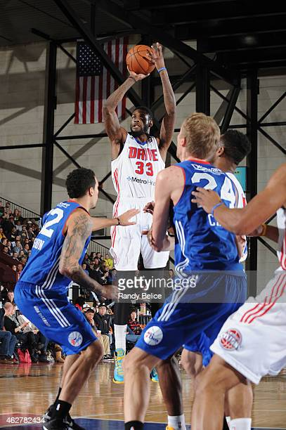 Willie Reed of the Grand Rapids Drive puts up a shot over Drew Gordon and Joonas Caven of the Delaware 87ers during the NBA D-League game on January...