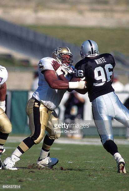 Willie Roaf of the New Orleans Saints blocks Alberto White of the Los Angeles Raiders during an NFL football game November 20 1994 at the Los Angeles...