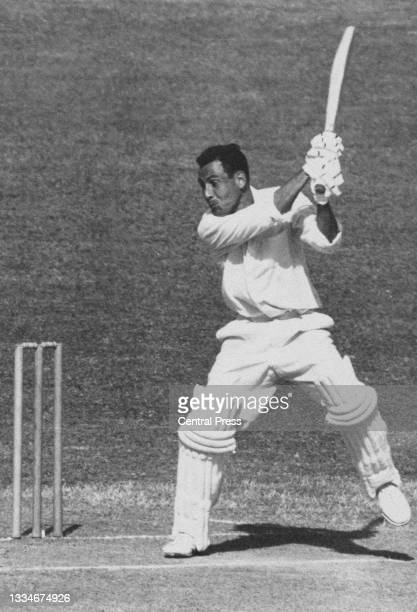 Willie Rodriguez of Trinidad and Tobago, right-handed batsman and all-rounder for the touring West Indian cricket team plays a shot to mid-wicket...