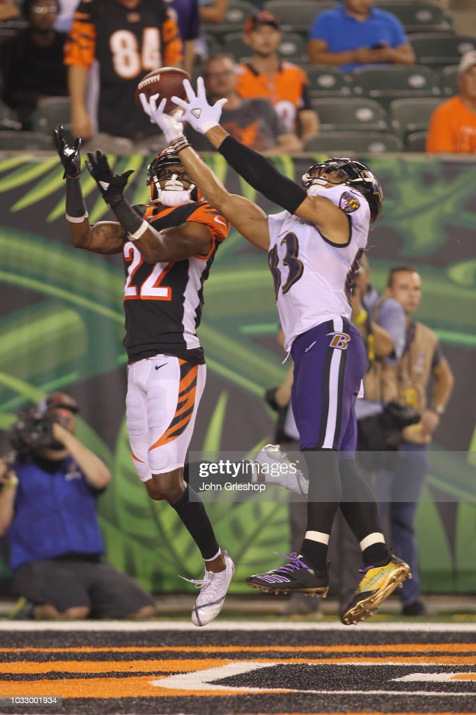 Willie Snead IV #83 of the Baltimore Ravens goes up for the football against William Jackson #22 of the Cincinnati Bengals during their game at Paul Brown Stadium on September 13, 2018 in Cincinnati, Ohio. The Bengals defeated the Ravens 34-23.