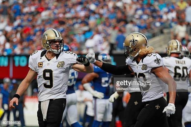 Willie Snead IV of the New Orleans Saints celebrates his touchdown with teammate quarterback Drew Brees against the New York Giants during the fourth...