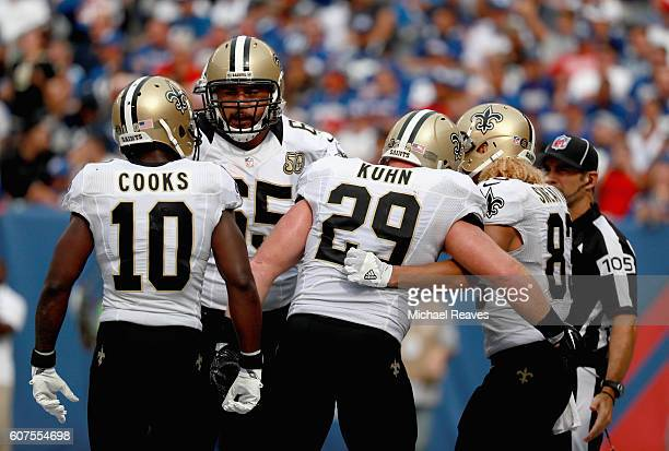 Willie Snead IV of the New Orleans Saints celebrates his touchdown with teammates Tony Carter Brandin Cooks and Senio Kelemete against the New York...