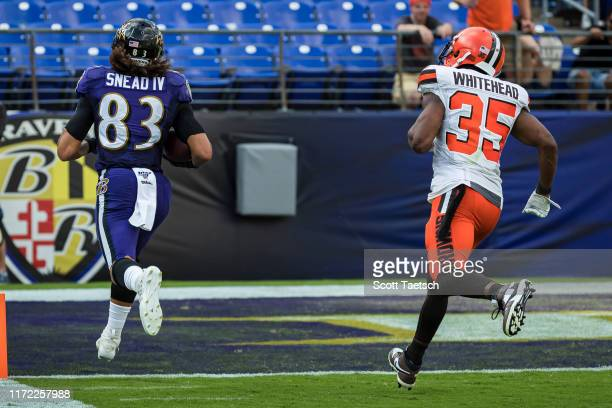 Willie Snead of the Baltimore Ravens catches a pass and runs for a touchdown against the Cleveland Browns during the second half at MT Bank Stadium...