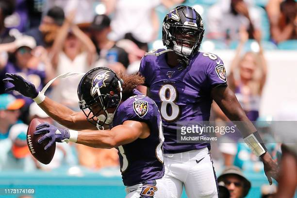 Willie Snead of the Baltimore Ravens celebrates with Lamar Jackson after scoring a touchdown against the Miami Dolphins during the second quarter at...