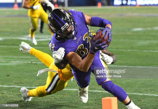 Willie Snead of the Baltimore Ravens gets past Marqui Christian of the Los Angeles Rams and runs into the end zone for a touchdown in the fourth...