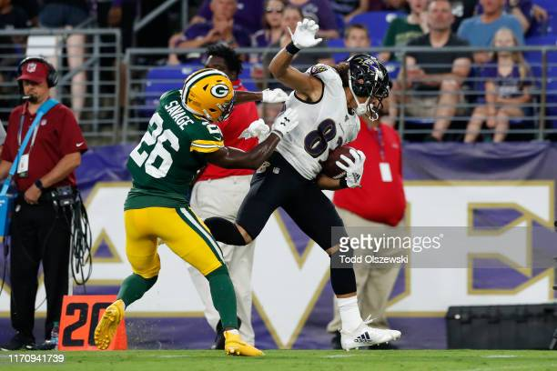 Willie Snead of the Baltimore Ravens is pushed out of bounds by Darnell Savage of the Green Bay Packers in the first half of a preseason game at MT...