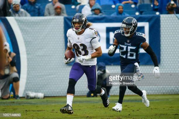 Willie Snead of the Baltimore Ravens runs with the ball while defended by Logan Ryan of the Tennessee Titans during the second quarter at Nissan...