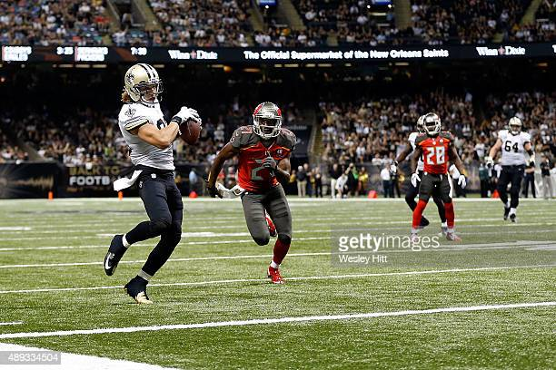 Willie Snead of the New Orleans Saints catches a pass for a touchdown in front of Alterraun Verner of the Tampa Bay Buccaneers during the fourth...