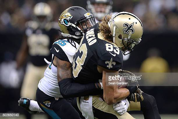 Willie Snead of the New Orleans Saints catches a pass in front of Demetrius McCray of the Jacksonville Jaguars during a game at the MercedesBenz...