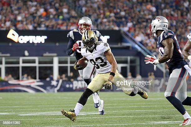 Willie Snead of the New Orleans Saints gains yards against the New England Patriots during a preseason game at Gillette Stadium on August 11 2016 in...