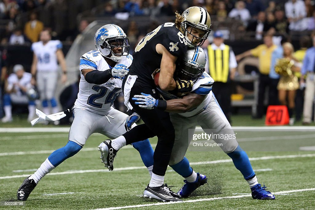 Willie Snead #83 of the New Orleans Saints is brought down by Stephen Tulloch #55 of the Detroit Lions during the second half of a game at the Mercedes-Benz Superdome on December 21, 2015 in New Orleans, Louisiana.