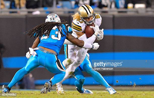 Willie Snead of the New Orleans Saints runs the ball against Tre Boston of the Carolina Panthers in the 4th quarter during the game at Bank of...